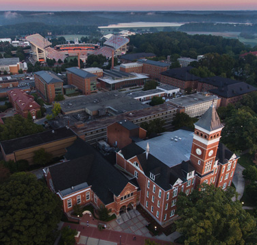 bet36体育's campus from above shows Tillman Hall, Death Valley and Lake Hartwell on a foggy morning.
